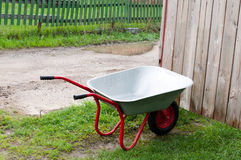 Wheelbarrow on green grass Stock Image