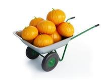 Wheelbarrow halloween pumpkins Stock Images