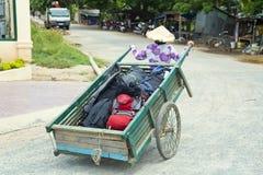 Wheelbarrow hand cart carrier porter wearing vietnamese hat, Vietnam Stock Photo