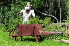 Wheelbarrow i strach na wróble Obraz Stock