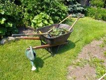 Wheelbarrow In Garden Royalty Free Stock Image