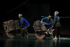 The wheelbarrow - Jiangxi opera a steelyard. Jiangxi opera a steelyard is adapted from a true story: the last century fortys, the protagonists father runs an oil Royalty Free Stock Photo