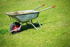Wheelbarrow on the lawn Royalty Free Stock Photography