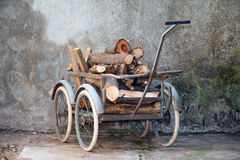 Wheelbarrow with a load of wood Stock Images