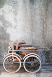 Wheelbarrow with logs Royalty Free Stock Photos