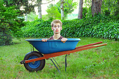 Wheelbarrow with man inside Stock Images