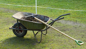 Wheelbarrow with manure Stock Photos