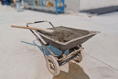 Wheelbarrow with mixed concrete Royalty Free Stock Images