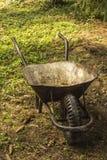 Wheelbarrow. Old wheelbarrow for autumn housework royalty free stock images