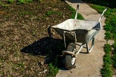 Wheelbarrow. Old wheelbarrow in the country side Royalty Free Stock Image
