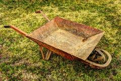 Wheelbarrow. An old rusty wheelbarrow in HDR royalty free stock photo