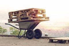 Wheelbarrow and pallets Stock Image