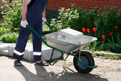 Wheelbarrow with paving slab Royalty Free Stock Images