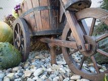 Wheelbarrow and pumpkins in the garden Royalty Free Stock Photo