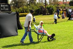Wheelbarrow racing  entertainment fun Kenya. Wheelbarrow  racing for children's entertainment and fun moments Royalty Free Stock Photography