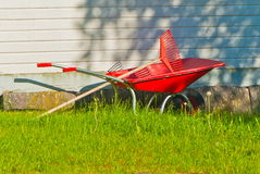 Wheelbarrow and rake Stock Photos