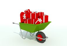 Wheelbarrow with red giftboxes Stock Photo