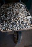 Wheelbarrow with rubble close up Stock Photos