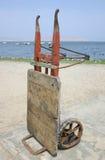 Wheelbarrow by the sea. In a fishing town of Peru Stock Photo
