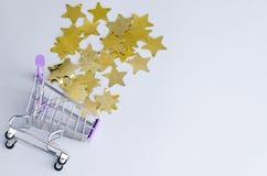 Wheelbarrow with shiny golden stars. stock photo