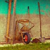 Wheelbarrow and shovel Stock Photo