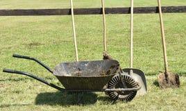 Wheelbarrow and shovel Stock Photography