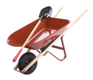 Wheelbarrow with shovels Stock Photos