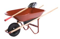 Wheelbarrow with shovels Royalty Free Stock Photo