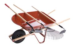 Wheelbarrow with shovels Royalty Free Stock Photos