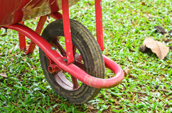 Wheelbarrow sitting in garden Royalty Free Stock Images