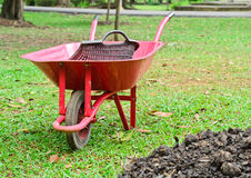 Wheelbarrow sitting in garden Stock Image