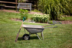 Wheelbarrow and spade Stock Photography