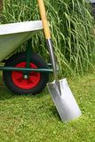 Wheelbarrow and spade Royalty Free Stock Image