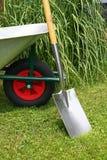 Wheelbarrow and spade Royalty Free Stock Image