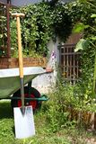 Wheelbarrow and spade Royalty Free Stock Photography