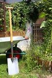 Wheelbarrow and spade Royalty Free Stock Photography