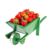 Wheelbarrow with strawberries Stock Image