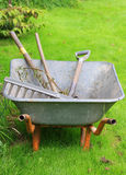 Wheelbarrow with tools Royalty Free Stock Image