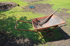Wheelbarrow and trays with new garden preparing Royalty Free Stock Image