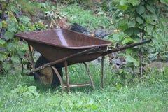 Wheelbarrow under the rain. A wheelbarrow under the rain Stock Photos