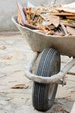 Wheelbarrow with waste Stock Image