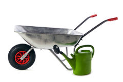 Wheelbarrow and watering can isolated Stock Image