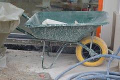 Wheelbarrow in work. Dirty wheelbarrow cart for building Royalty Free Stock Photo