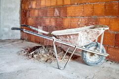 Wheelbarrow in workplace Royalty Free Stock Images