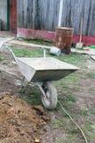Wheelbarrow z piaskiem Zdjęcie Royalty Free