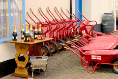 Wheelbarrows and champagne Stock Images