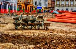 Wheelbarrows. Construction site with wheelbarrows in Timisoara, Romania Royalty Free Stock Photo