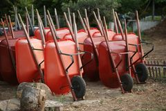 Wheelbarrows in garden Royalty Free Stock Image
