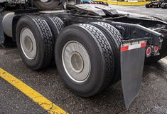 Wheelbase of big rig semi truck with two axles and pairs of wheels on them and fifth wheel for coupling. Wheelbase of industrial grade professional big rig stock images