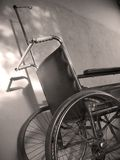 Wheelchair. Old hospital wheelchair with shadow stock photography